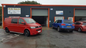 VW Transporter in front of Garage forecourt